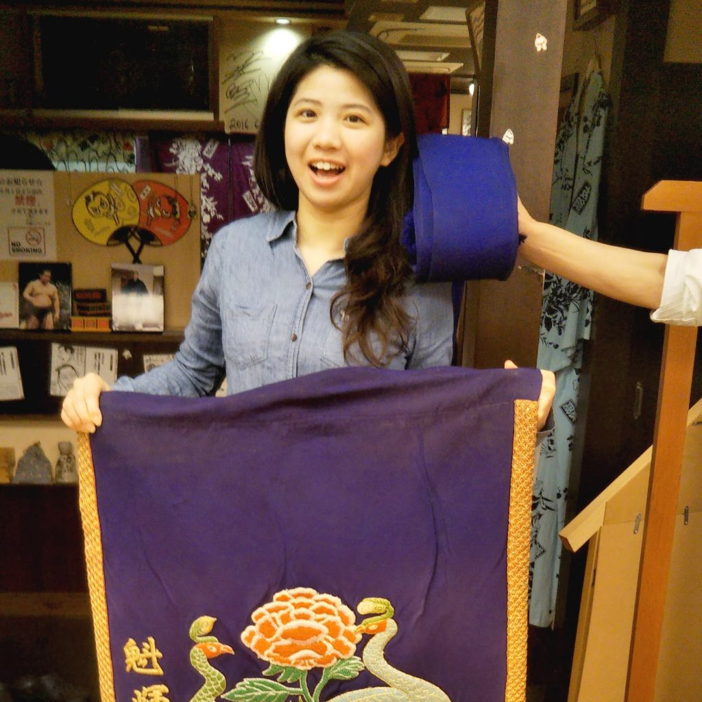 The dazzling decorative apron sumo wrestlers wear is insanely heavy!